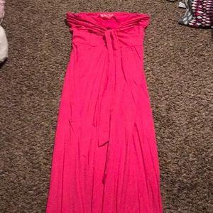 Pink strapless maxi dress.
